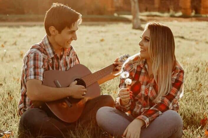 Couple having fun, acoustic moment together.