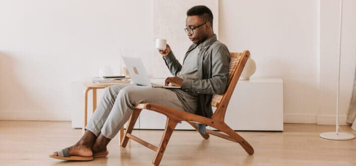 Guy having a cup of coffee while researching,