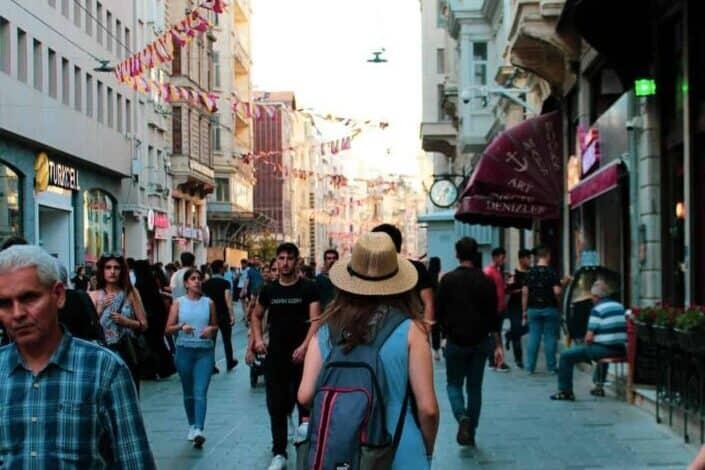 People walking in the street near buildings
