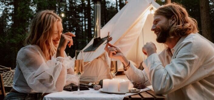 a couple having a date by a tent