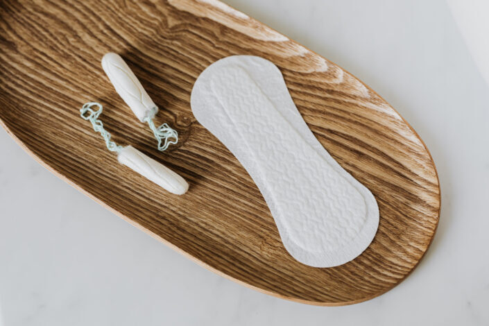 Products of personal hygiene for women on wooden dish