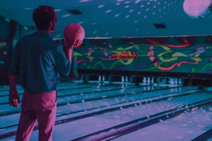 Unrecognizable man standing near bowling lane