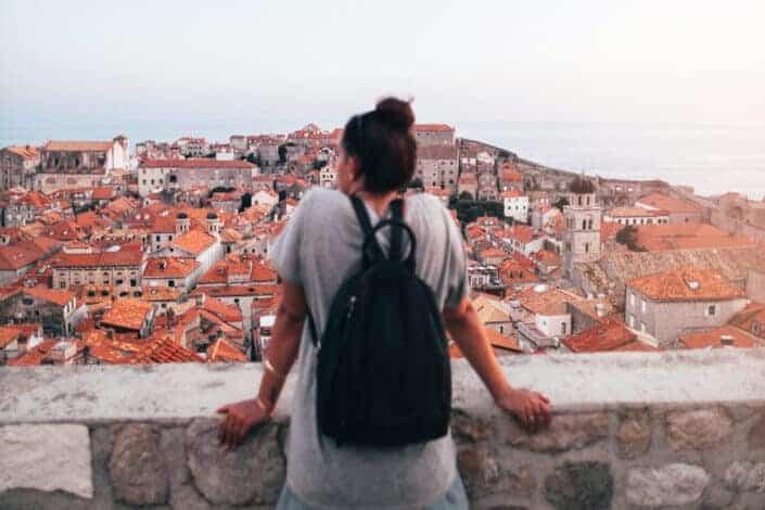 Woman looking at buildings