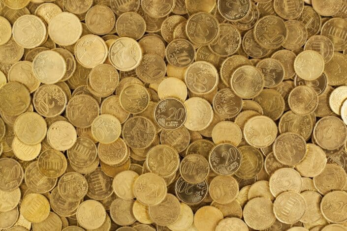 gold coins on a flat surface