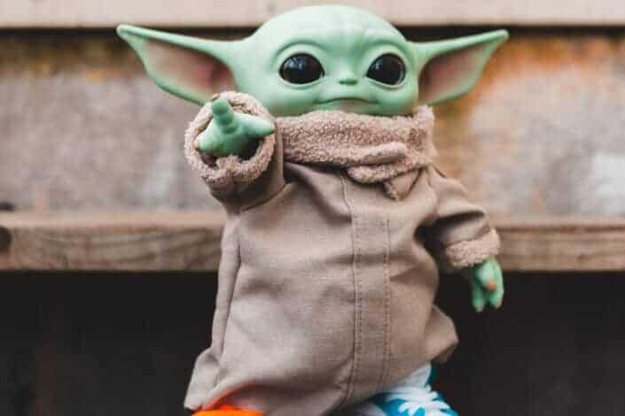 baby Yoda toy wearing sneakers