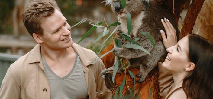 Happy couple with adorable funny koala