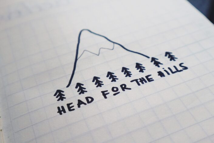Head for the hills written on paper