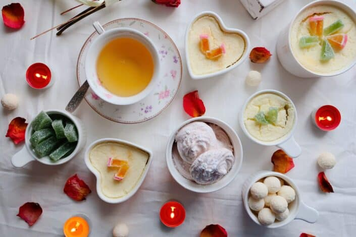 Food inside circle and heart-shaped plates and cups