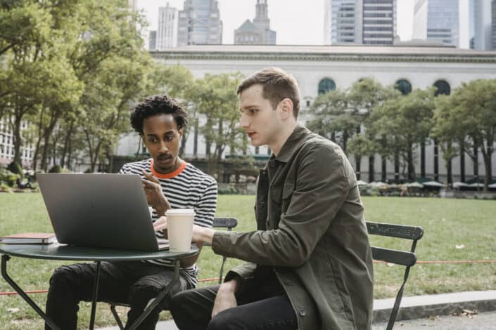 Two men looking seriously at a laptop