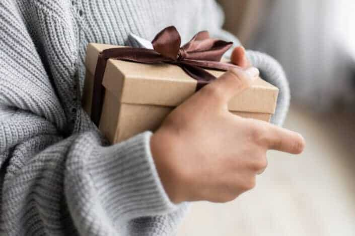 Woman holding a box of gift
