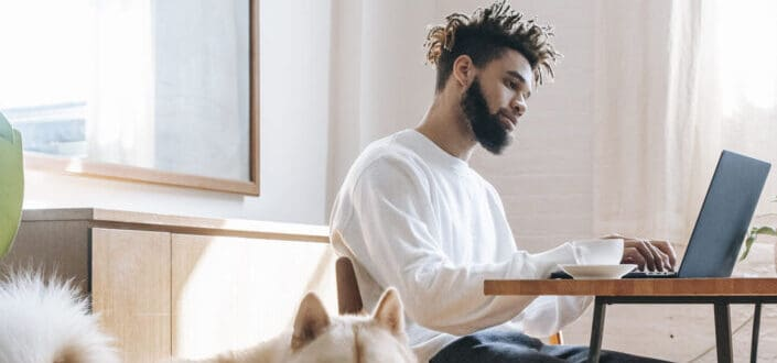 Bearded man working on his laptop