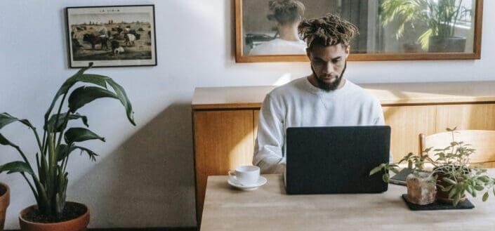 Man browsing laptop at home