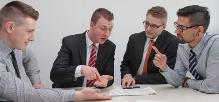 Men in formal attire having serious discussion