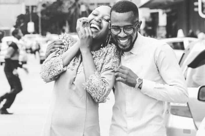 A dressed up couple laughing