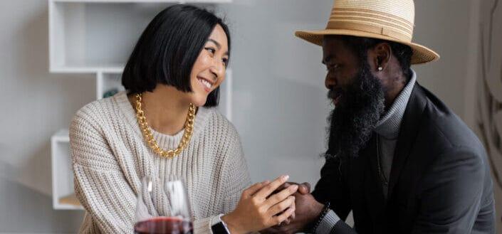Happy diverse couple having dinner