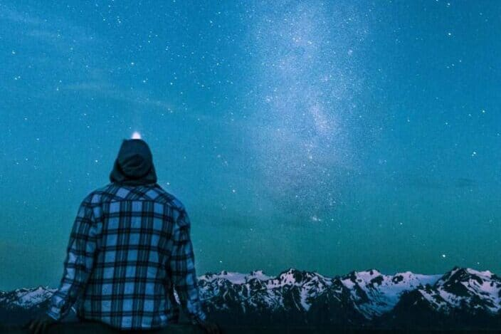 A person looking at the night sky.