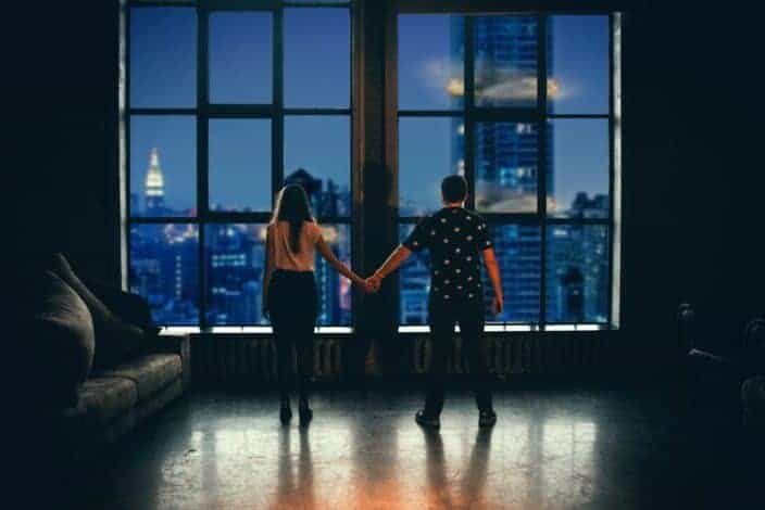 couple holding hands as if in fight club
