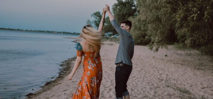 Couple dancing by the beach