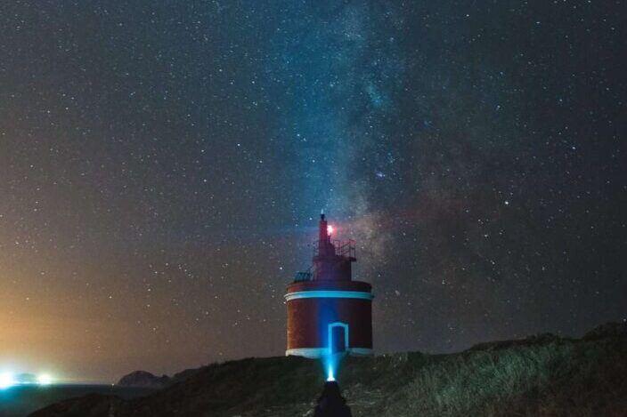 View of lighthouse under the beautiful night sky.