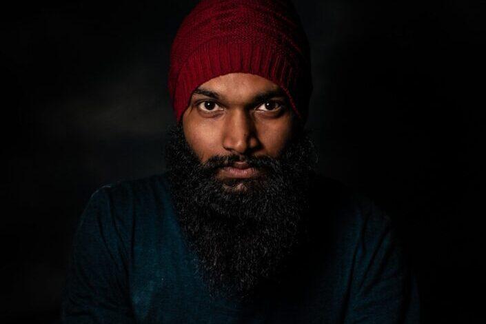 dark man with long beard being fierce