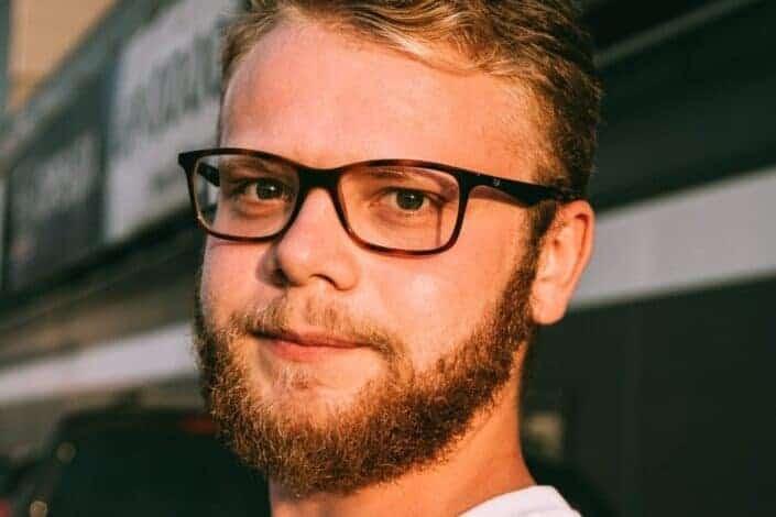 man with beard wearing glasses