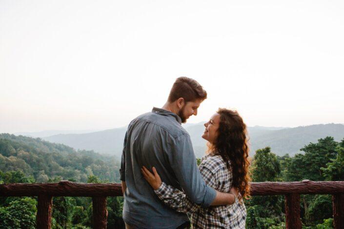 loving couple embracing each other on veranda