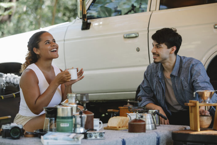 Two people laughing while having snacks