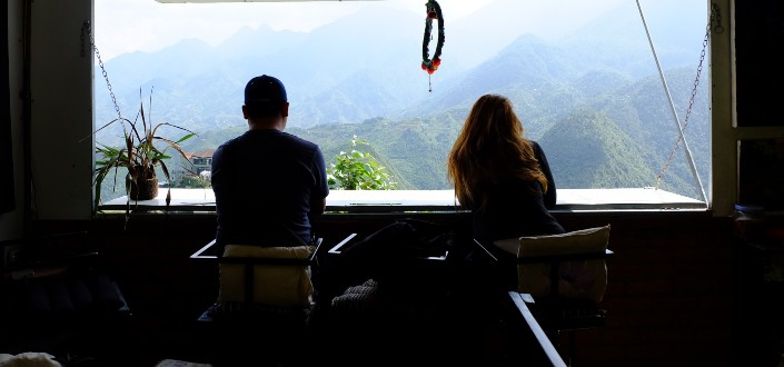 silhouette of couple looking outside