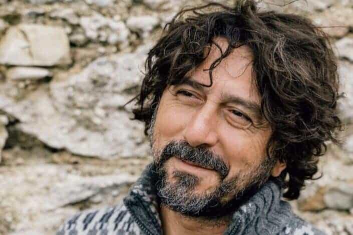 Smiling dark-haired Italian guy in a grey jumper