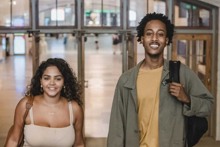 Couple smiling together, on for a travel.
