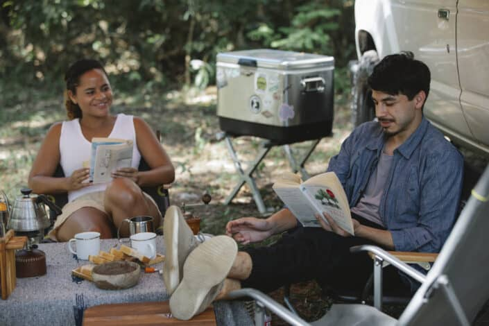 Couple reading books happily together