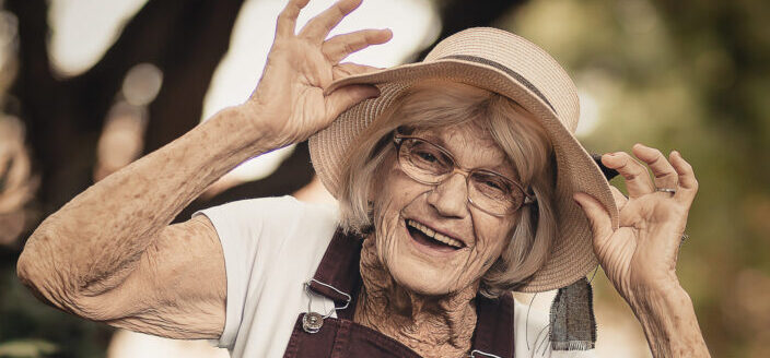 happy old woman wearing a hat