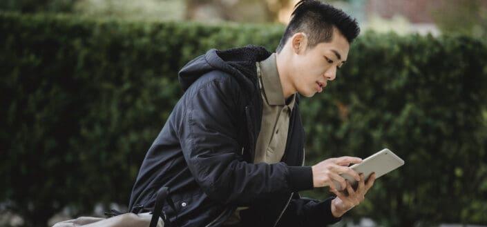 A man looking at his tablet
