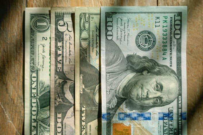 US dollar bills on a table