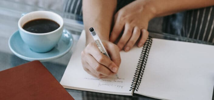 Woman writing in a notepad