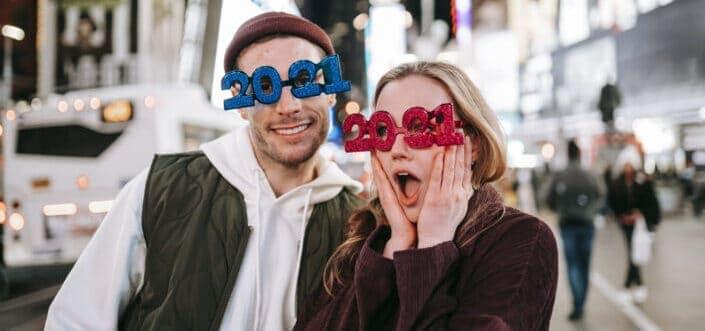 couple wearing 2021 decorated eyeglasses