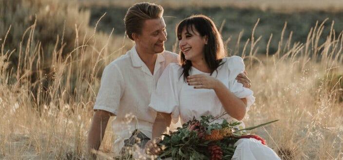 Happy couple enjoying romantic date in rural field