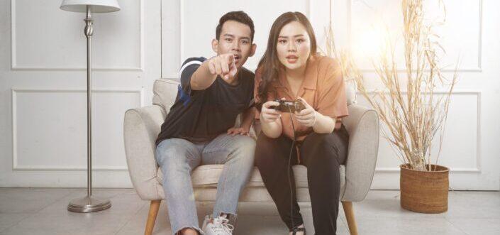 Man teaching his girl how to play