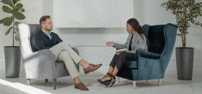 Man and woman sitting on couch