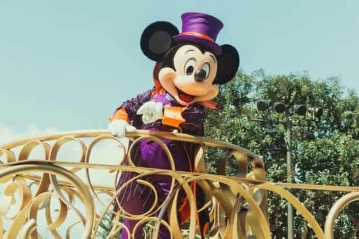 mickey mouse riding on yellow horse