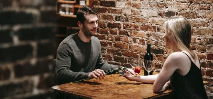 Romantic couple having date in cafe with wine