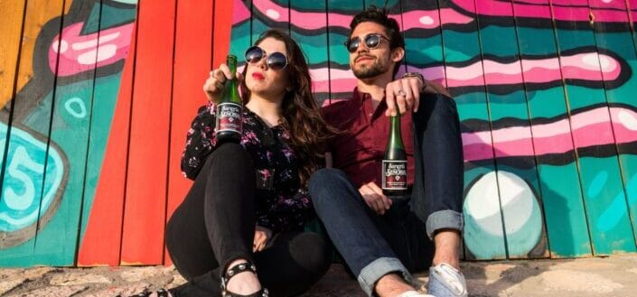 Sangria Senorial Couple relaxing in front of Mural