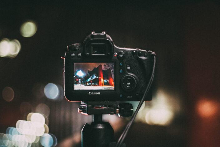 Selective focus photography of black canon camera