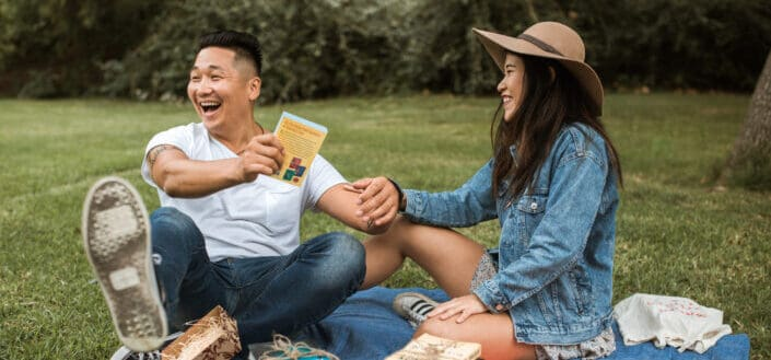 couple laughing on their picnic