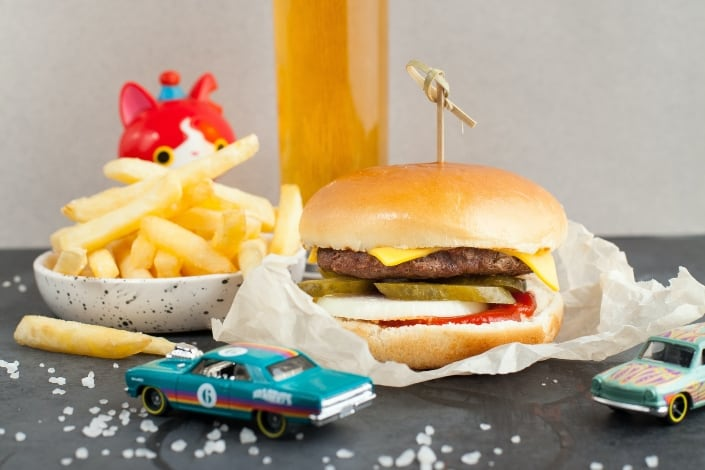 burger and fries surrounded by toys