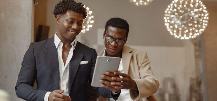 happy businessmen browsing tablet