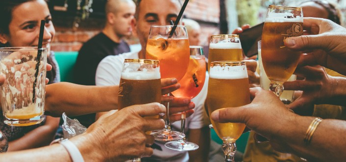 a group of friends toasting their drinks