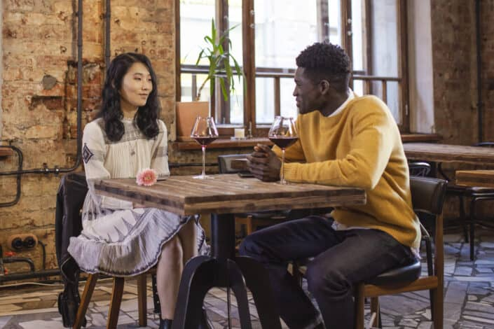 man and woman having casual date in restaurant