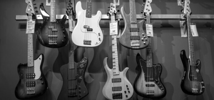 A display of bass guitars in the store