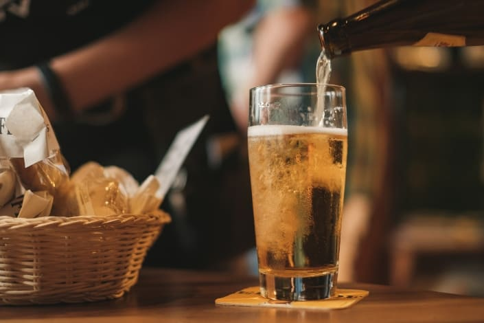 pouring beer into a glass